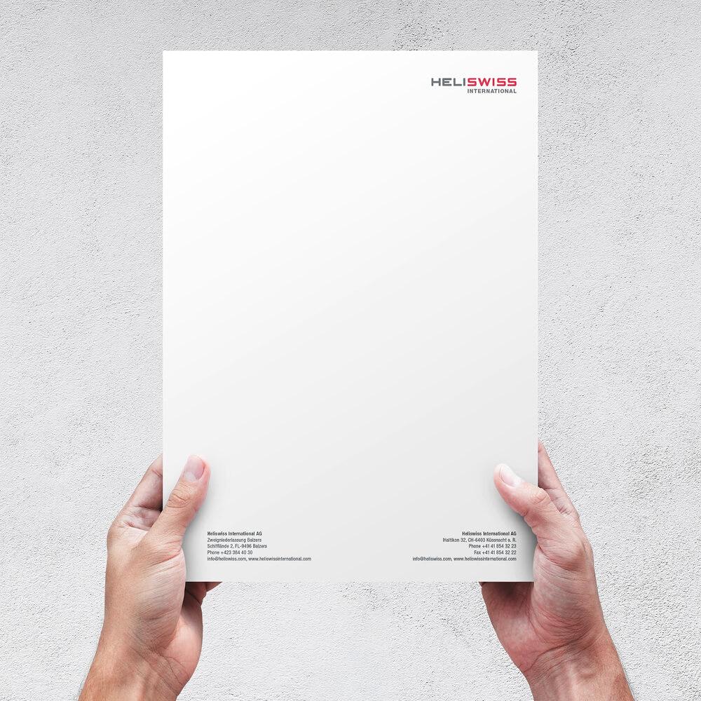 Briefpapier Heliswiss International als Kundenreferenz von Bacher PrePress