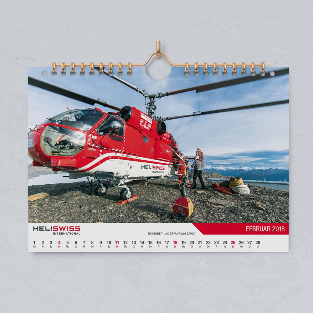Kalender Heliswiss International als Kundenreferenz von Bacher PrePress