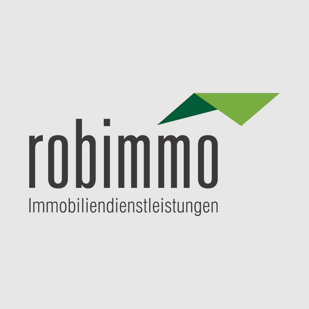 Logo Robimmo AG als Kundenreferenz von Bacher PrePress